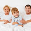 Family is in the morning in bed — Stock Photo #13142592