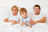 Family is in the morning in bed — Stock Photo