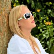Stock Photo: Portrait of womwith sunglasses