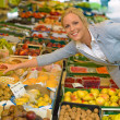 Woman at the fruit market with basket — Stock Photo #13553445