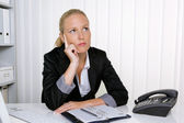 Pensive business woman in office — Stock Photo