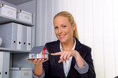 Real estate agent in her office — Stock Photo