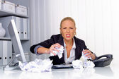 Woman in office with crumpled paper — Stock Photo
