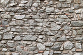 A stone wall as background — Stock Photo