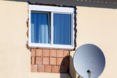 New window with satellite dish — Stock Photo