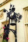 Dzwon na ścianie domu — Zdjęcie stockowe