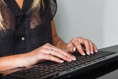 Woman with computer keyboard — Stock Photo