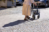 Woman with a walker — Stock Photo
