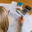 Woman with unpaid bills and debts — Stock Photo