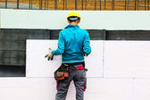 Construction workers and insulation — Stock Photo