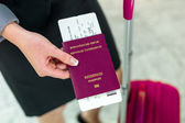Businesswoman with passport — Stock Photo