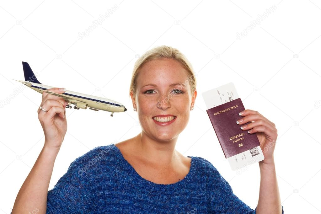 A woman with the model of an aircraft looking forward to your next flight. with ticket and passport  Stock Photo #14049678