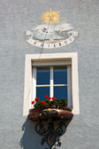 Sundial on a house — Stock Photo