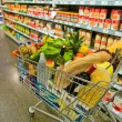 Cart in a supermarket — Stock Photo