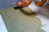 Tiler at work — Stock Photo