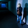 Woman in the tunnel is afraid — Stock Photo