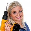 Woman in blue work clothes with a drill — Stock Photo