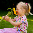 Child with sunflower in the garden in summer — Stock Photo