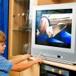 Stock Photo: Small child in television