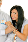 Woman pulls a man out of his pocket swiss francs — Stock Photo