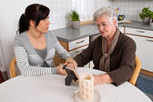 Woman consoling the widow of death. bereavement support. — Stock Photo
