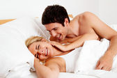 Couple has fun in bed — Stock Photo