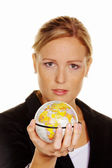 Women with a globe in her hand — Stock Photo