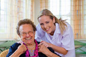 Home care of the old lady — Stock Photo
