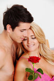 Couple in bed with rose. proposal of marriage — Stock Photo