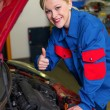 Woman as a mechanic in car workshop — Stock Photo