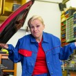 Stock Photo: Woman as a mechanic in car workshop