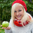 Woman with apple. vitamins in autumn — Stock Photo #15565385