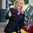 Woman at gas station to refuel — Stock Photo #15568219