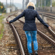 Royalty-Free Stock Photo: Woman balancing on track. decisions