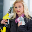 Woman at gas station to refuel — Stock fotografie