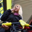Woman at gas station to refuel — Stock Photo #15568715
