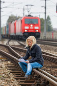 Woman suicide with thoughts on track — Stock Photo