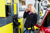 Woman at gas station to refuel — Stok fotoğraf