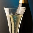 Champagne glass with champagne bottle — Stock Photo