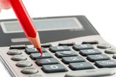 Red pencil and calculator — Stock Photo
