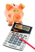 Cutbacks, piggy bank and calculator — Stok fotoğraf