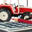 Tractor, red pencil and calculator — Stock Photo