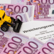 Insurance contract for new excavator — Stock Photo