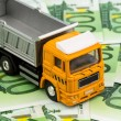 Stock Photo: Trucks and euro banknotes money