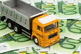 Trucks and euro banknotes money — Stock Photo