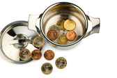 Saucepan and euro coins — Stock Photo