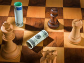 Chess with dollar and euro banknote. dollar depreciation. — Stock Photo