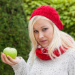 Woman with apple. vitamins in autumn — Stok fotoğraf