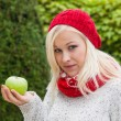 Woman with apple. vitamins in autumn — Foto de Stock
