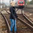 Woman balancing on track. decisions — Stok fotoğraf